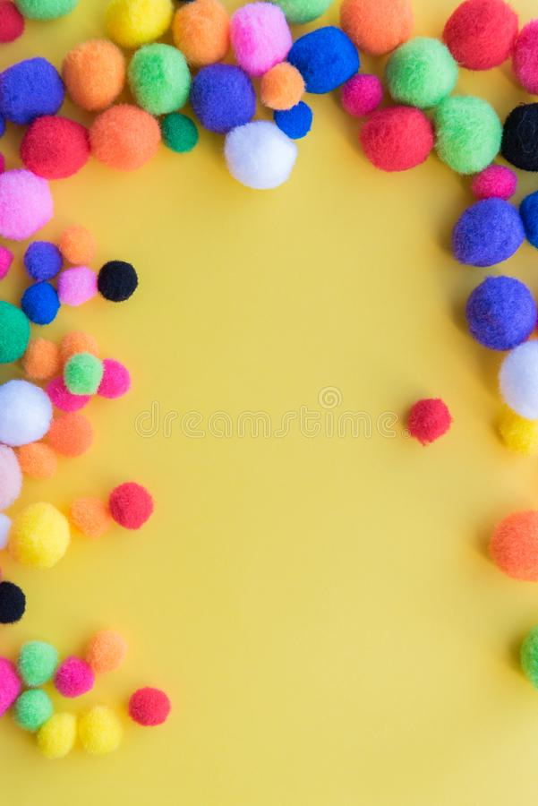 Bright Multi-colored Pom-poms Arranged As A Border On A Solid Yellow - solid green border