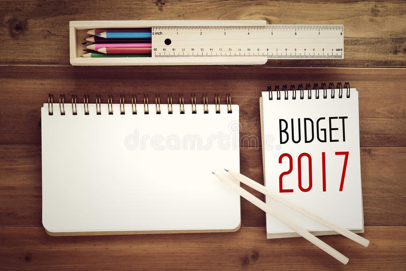 2017 Budget Word On Notebook Paper Background Stock Image - Image of