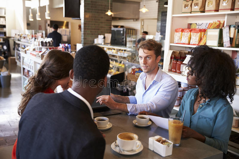 Business Group Having Informal Meeting In Cafe Stock Photo - Image