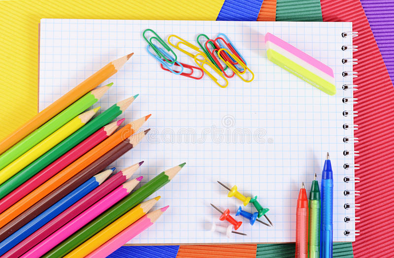 Color Pencils On Paper With Notebook Stock Photo - Image of group - colored writing paper