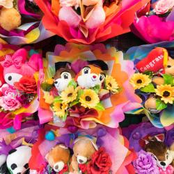 Colorful Bunches of Cute Soft Toys With Flowers Stock Photo