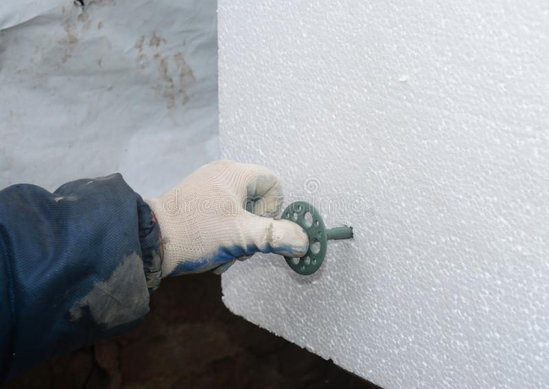 Contractor Installing Styrofoam Rigid Insulation Board How To - Concrete Wall Insulation