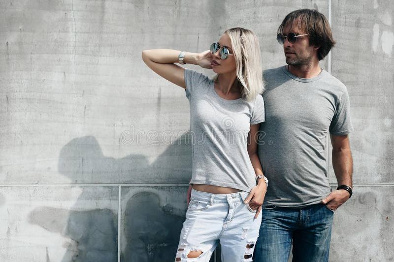 Mockup T Shirt Couple Free Couple In Gray T-shirt Over Street Wall Stock Photo