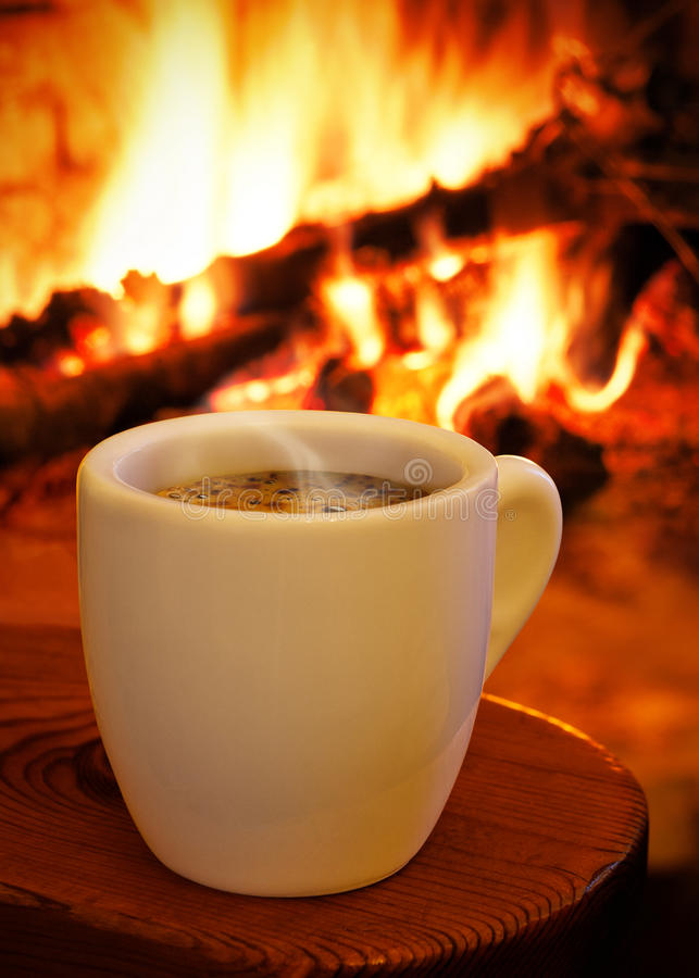 Cozy Fall Wallpaper A Cup Of Hot Coffee In Front Of The Fireplace Stock Photo
