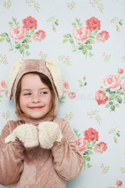 Cute Girl In Bunny Costume Against Wallpaper Stock Photo - Image: 33855614