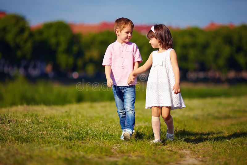 Cute Child Couple Wallpaper Hd Cute Kids Couple Walking On Summer Field Stock Photo