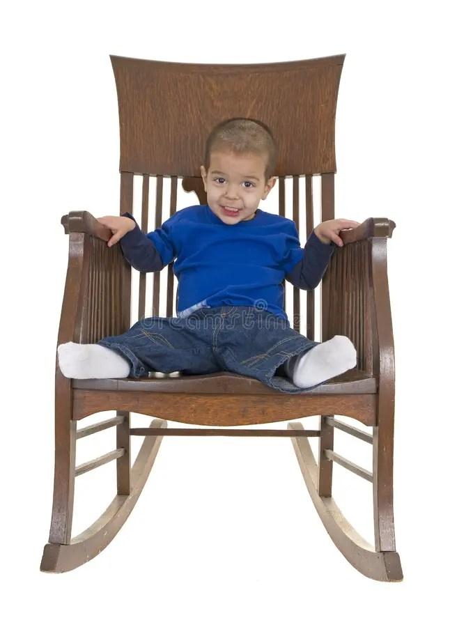 Cute Little Boy On Rocking Chair Stock Photo