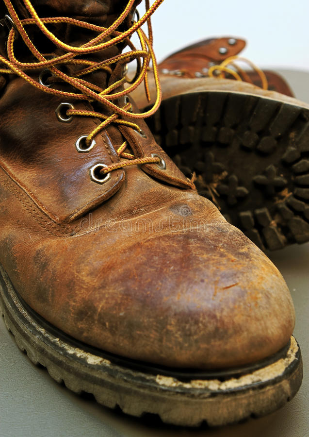 Dirty Work Boots With Mud And Scratches Stock Photo