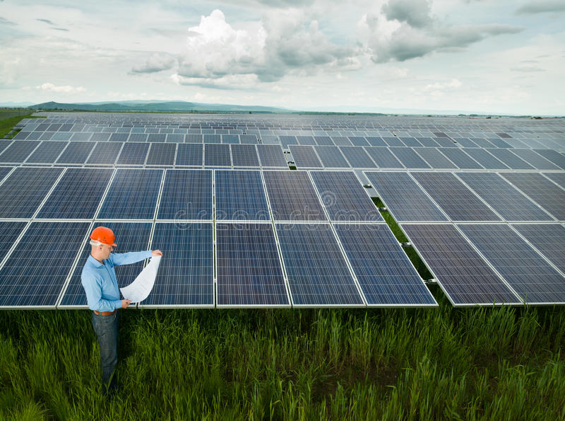 Electrician Examining Solar Panel Blueprint Stock Photo - Image of