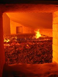 Fire in the boiler grate stock image. Image of energy