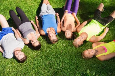 Group Of Happy Sporty Friends In Circle Outdoors Stock ...
