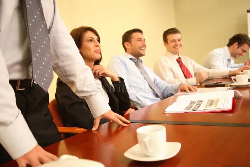 Group Of People Having Fun During Informal Business Meeting Stock