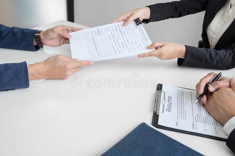Interviewer Or Board Reading A Resume During A Job Interview, Em - interviewer resume