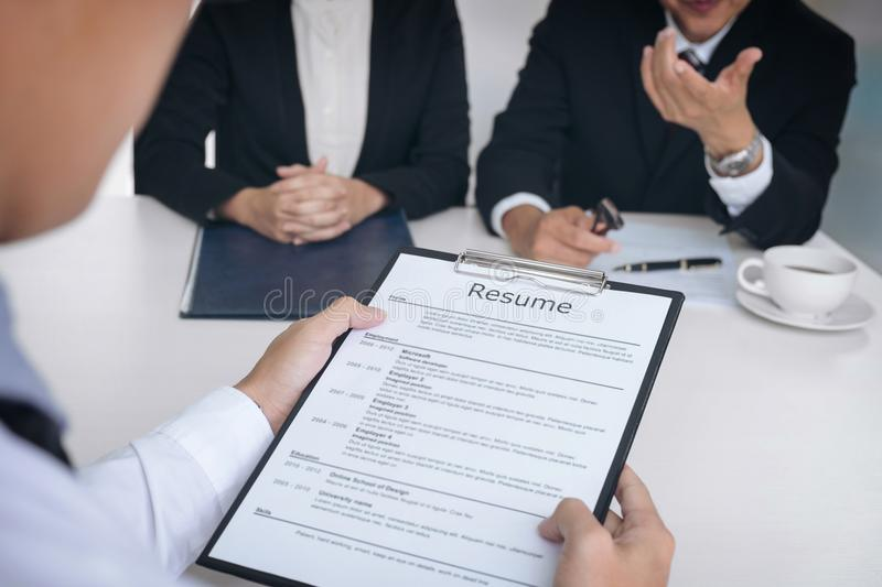 Interviewer Or Board Reading A Resume During A Job Interview Stock - interviewer resume