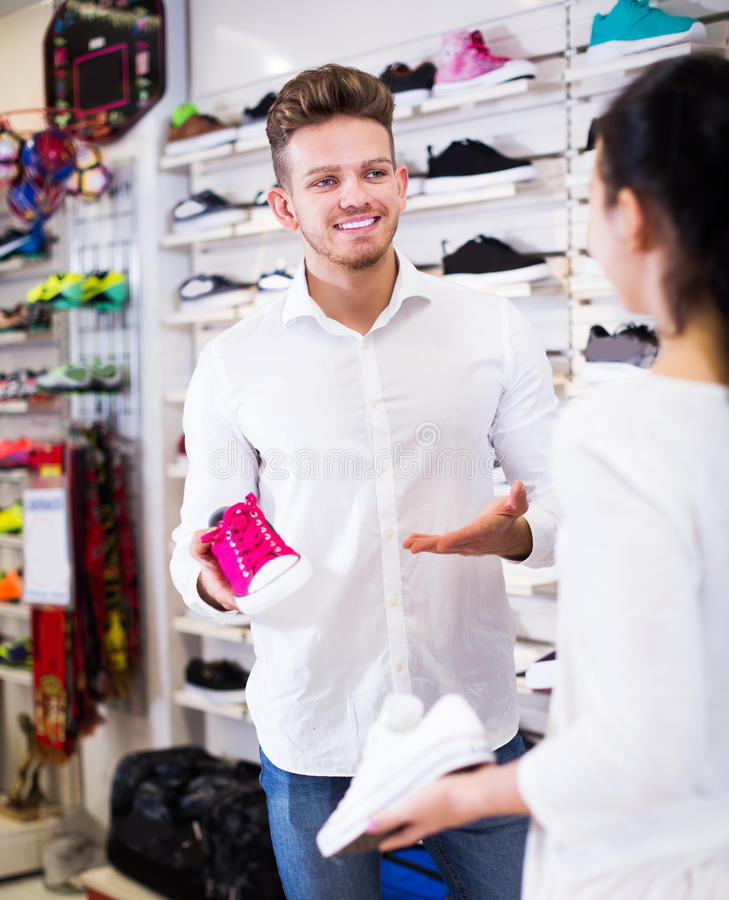 Male Shop Assistant Helping Customer Stock Photo - Image of - shop assistan