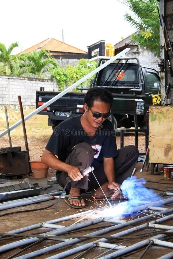 Male Welder/fabricator Welding Metalwork In Workshop Editorial Stock - welder fabricator