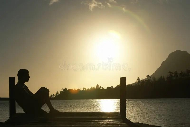 Lonely Girl Walking In Rain Wallpaper Man Sitting On Dock By Lake Stock Photo Image Of Leisure
