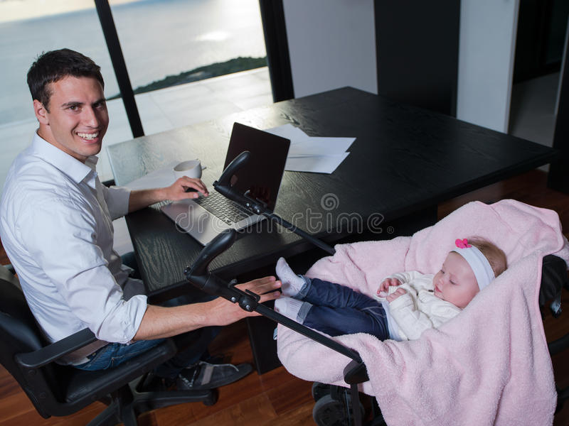Home Office Mit Baby Man Working From Home And Take Care Of Baby Stock Image