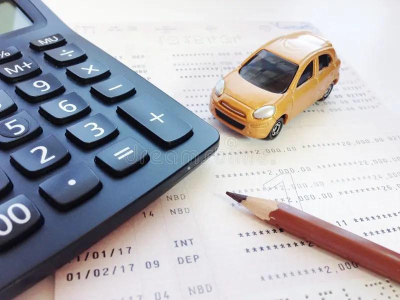 Miniature Car Model, Pencil, Calculator And Savings Account Passbook