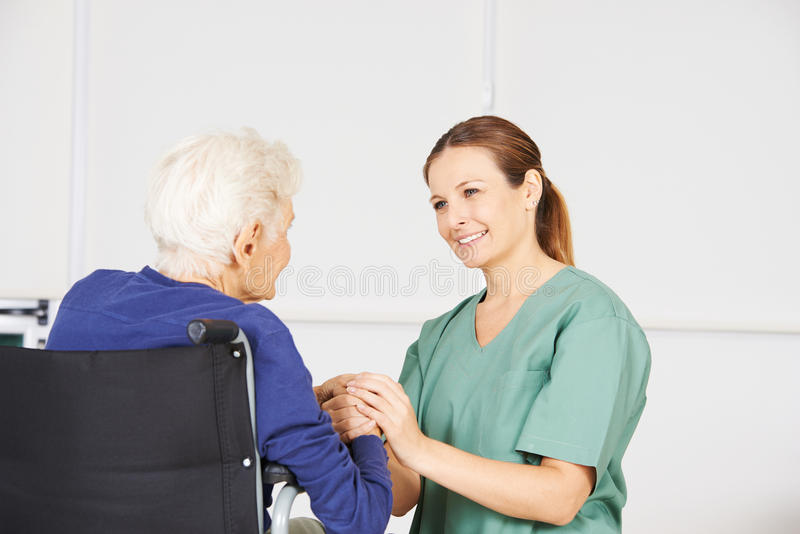 Old Woman As Patient With Geriatric Nurse Stock Photo - Image of