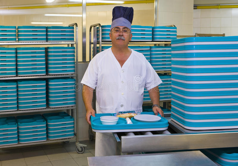 Porter With Plastic Trays In Hospital Kitchen Stock Image - Image of - hospital porter