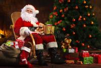Santa Claus Sitting In Front Of Fireplace Stock Photo ...