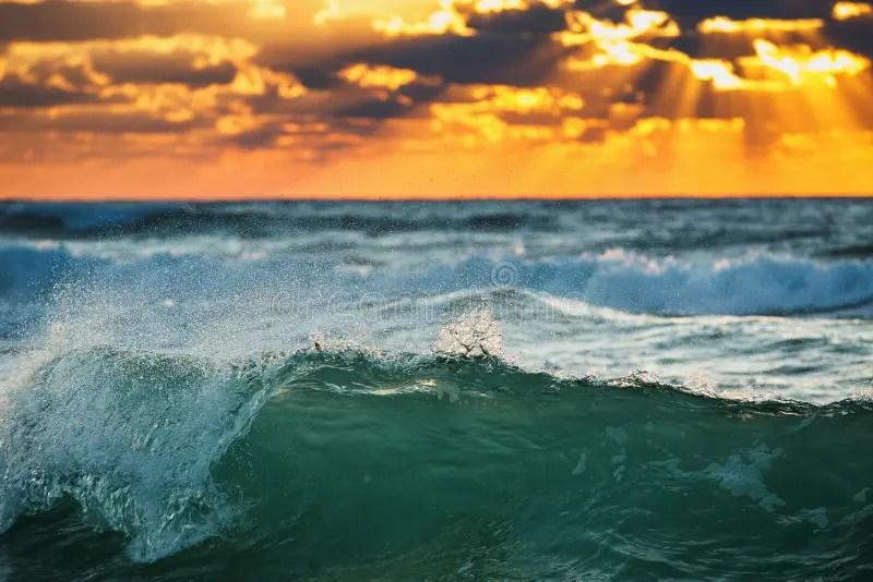 Sunrise Wave Ocean Waves Crashing Onto The Shore Stock Photo