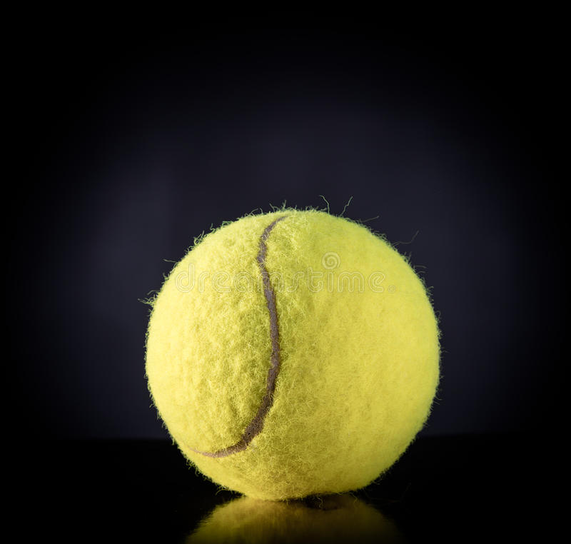 Tennis Ball On Black With Dramatic Lighting Stock Illustration