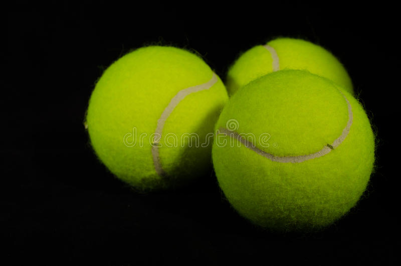 Tennis Balls Black Background 3 Stock Photo - Image of fuzz, green - why is there fuzz on a tennis ball