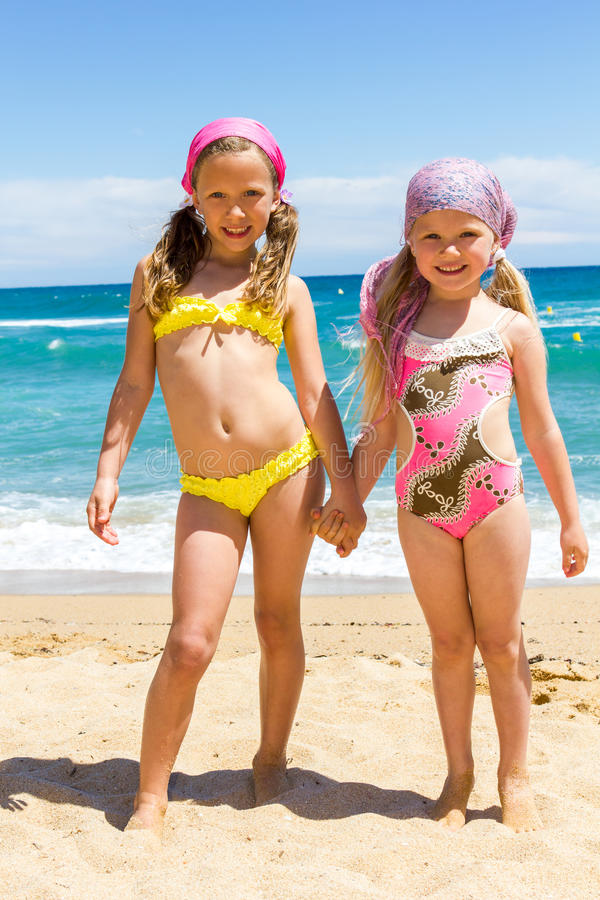 Familie Zwembad Xl Two Girls In Swimwear On Beach. Stock Photo - Image Of