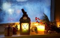 Warm Lantern On Frozen Window With Decoration Stock Photo ...