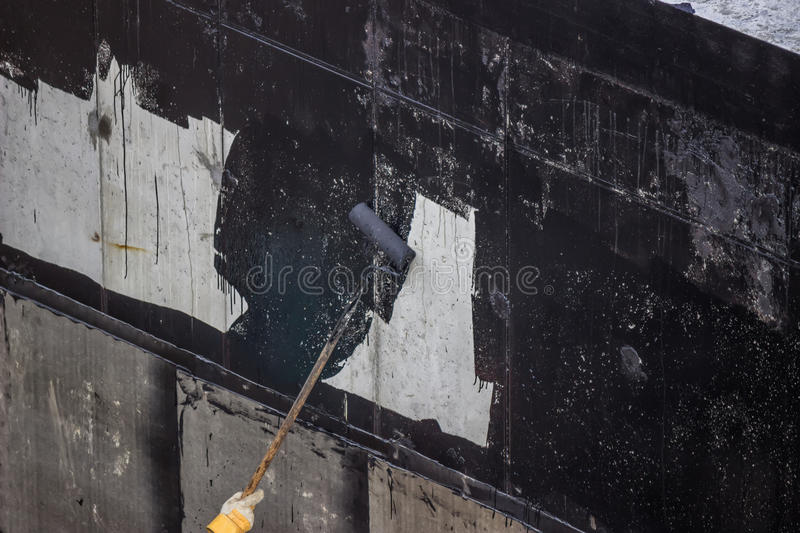 Waterproofing, Worker Painting Exterior Concrete Wall With Tar I - Concrete Wall Insulation