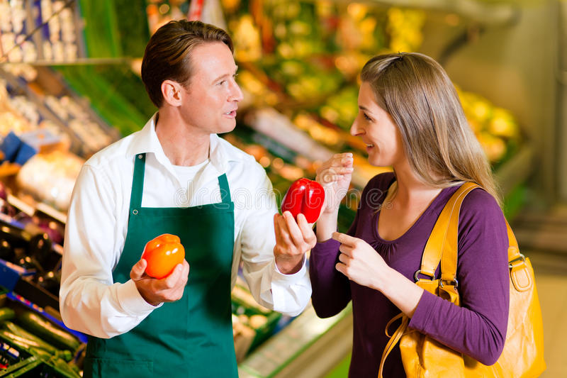 Woman In Supermarket And Shop Assistant Stock Image - Image of - shop assistan