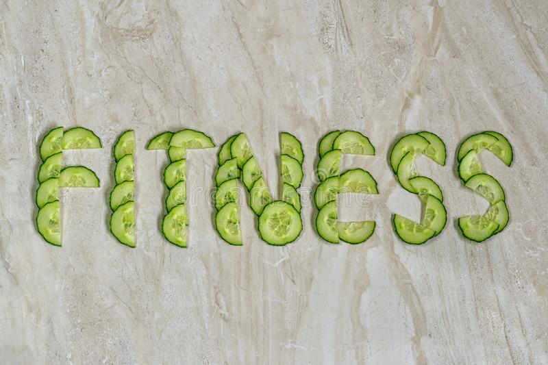 The Word Fitness Is Laid Out By Cucumbers Stock Image - Image of