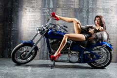 3d Wallpaper Motorcycle Wheelies Young Woman Sitting On Motorcycle Royalty Free Stock