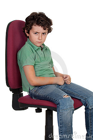 Angry Little Boy Sitting On Big Chair Royalty Free Stock