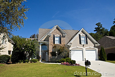 Grey stucco and stone house stock photography image