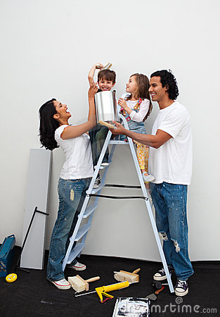 Happy Family Painting A Room Stock Images - Image: 12809724