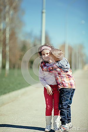 Cute Young Couple Hd Wallpaper Little Boy Kiss Girl On The Street Stock Photo Image