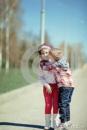 Cute Couple Kisses Wallpaper Little Boy Kiss Girl On The Street Stock Photo Image
