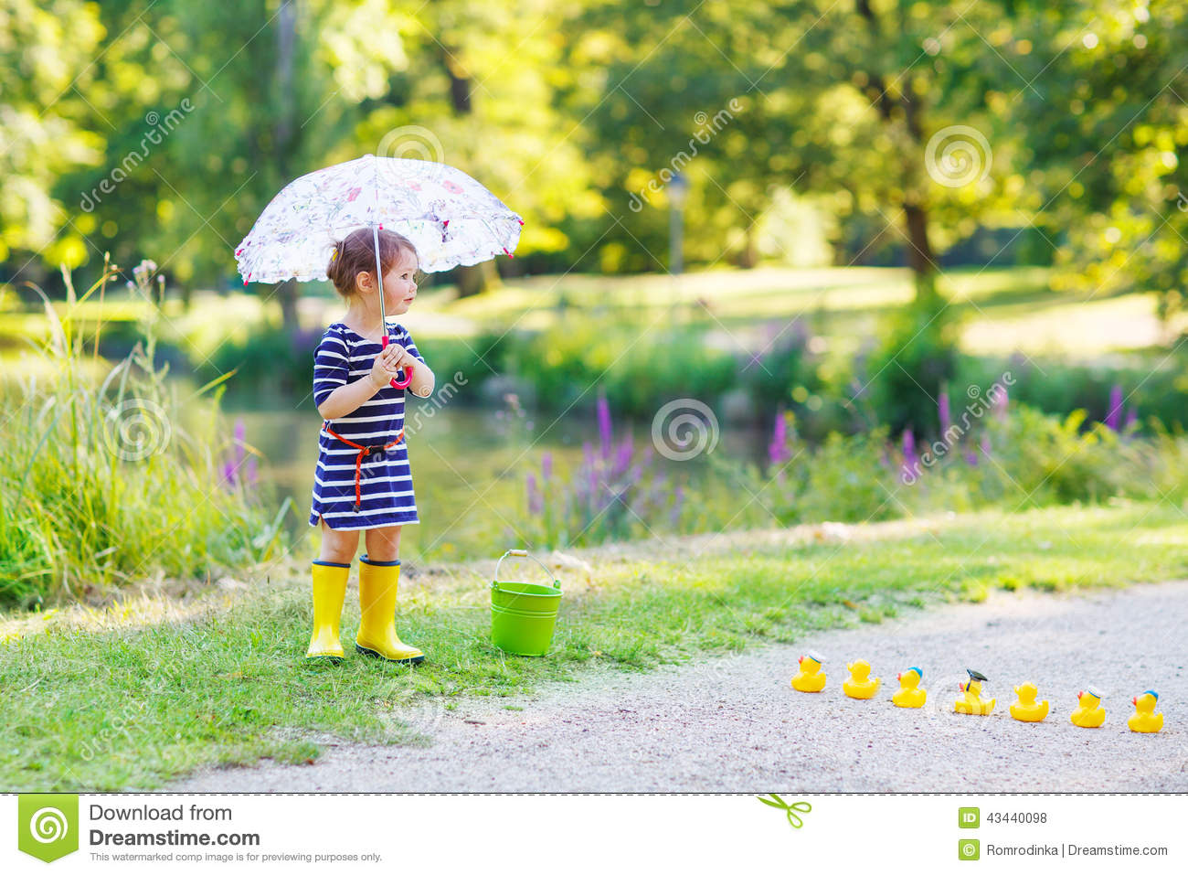 Adorable Little Child In Yellow Rain Boots And Umbrella In