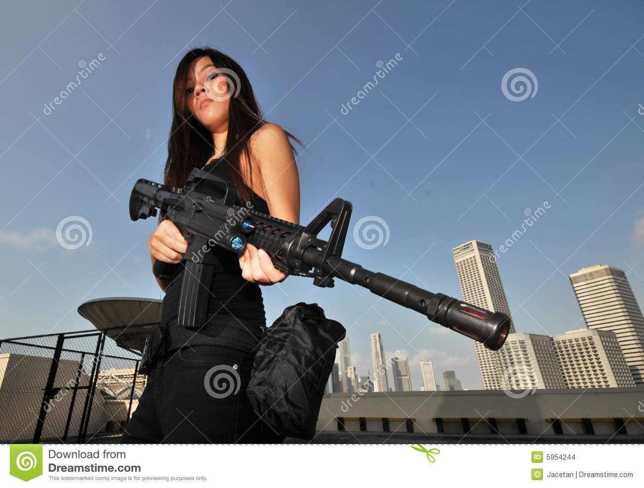 China Beautiful Girl Wallpaper Asian Female Holding A Mean Rifle Overlooking City Stock