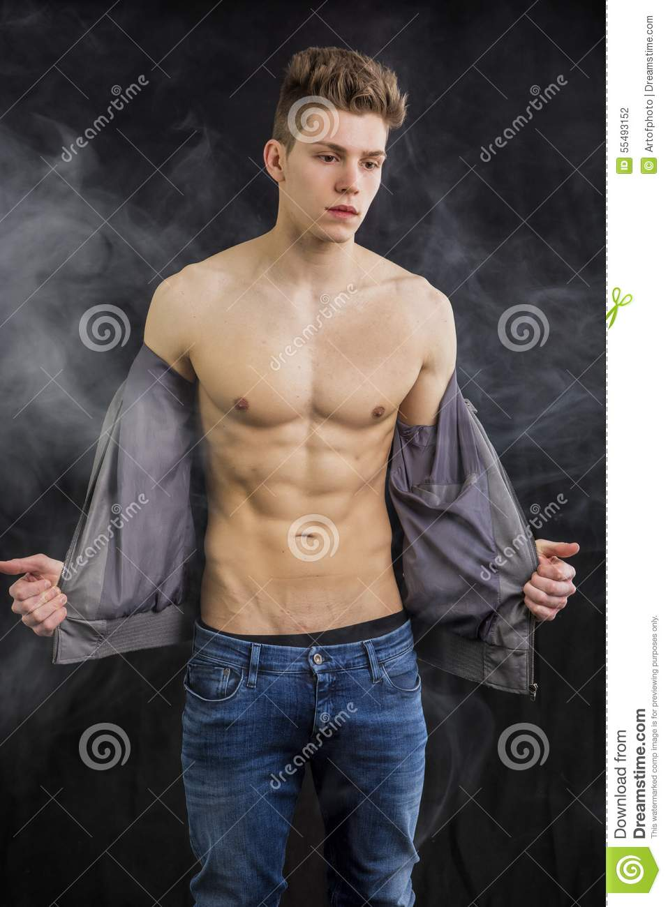 Stylish Hair Style Of Man Attractive Muscular Trendy Young Man Undressing Stock