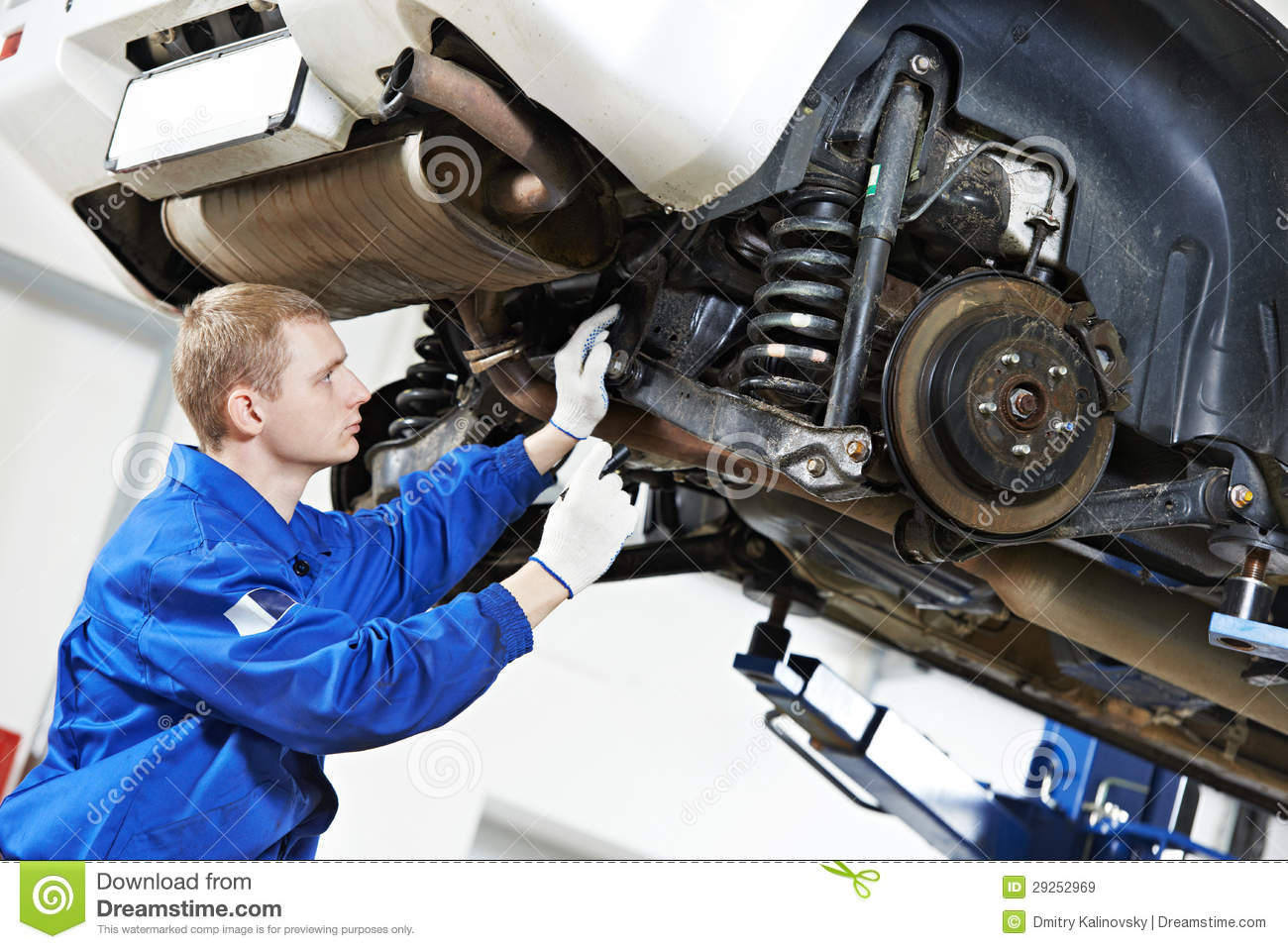 Reparation Automobile Auto Mechanic At Car Suspension Repair Work Stock Image Image Of