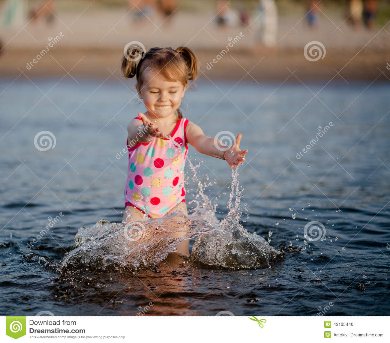 Cute Little Girl In Rain Wallpaper Baby Girl Playing With A Water In The Sea Stock Photo