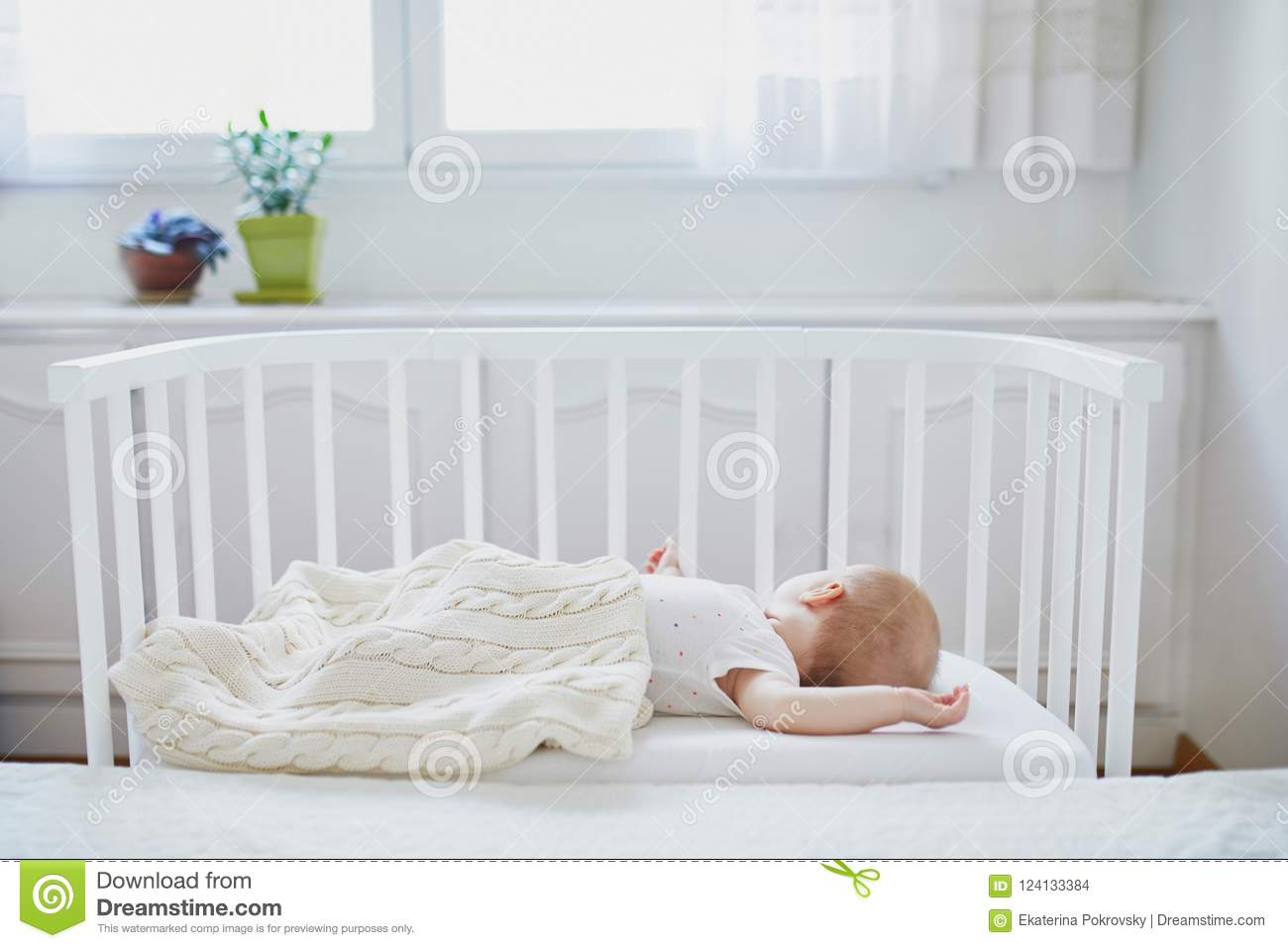 Baby Cots That Attach To Beds Baby Girl Sleeping In Co Sleeper Crib Stock Photo Image Of