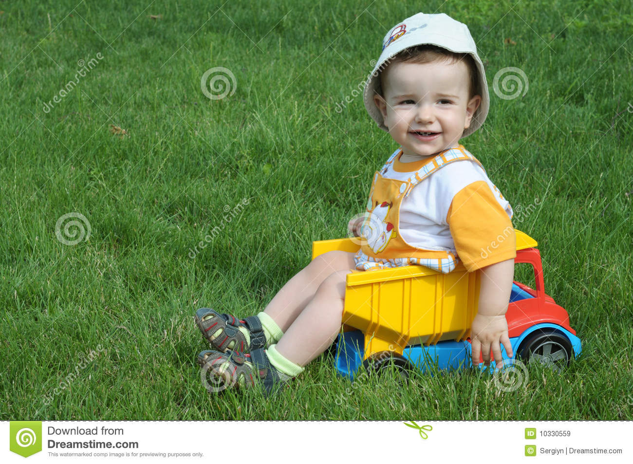 Baby Truck A Baby In The Truck On The Grass Stock Photography