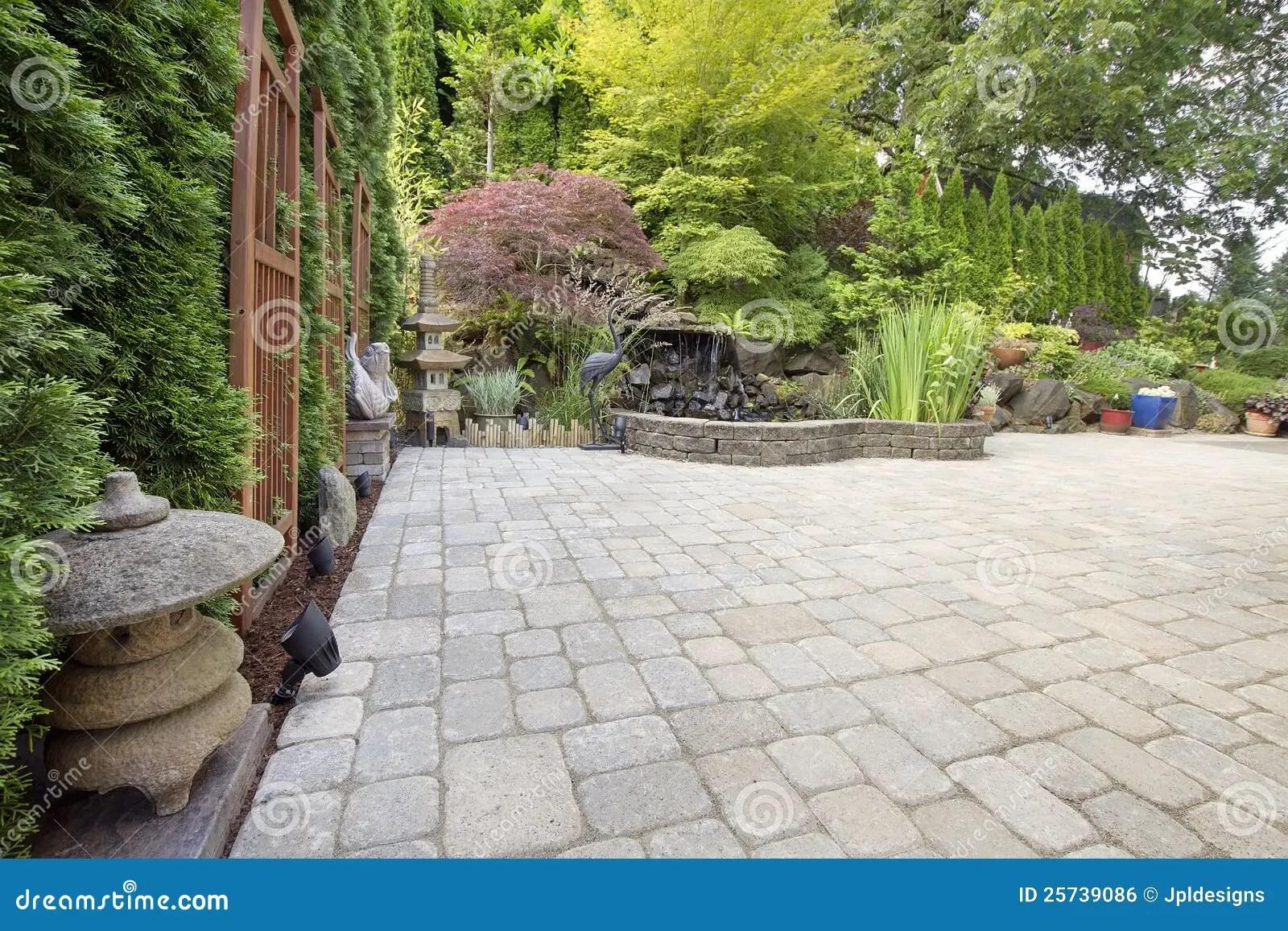 Backyard Asian Inspired Paver Patio Garden Stock Photo
