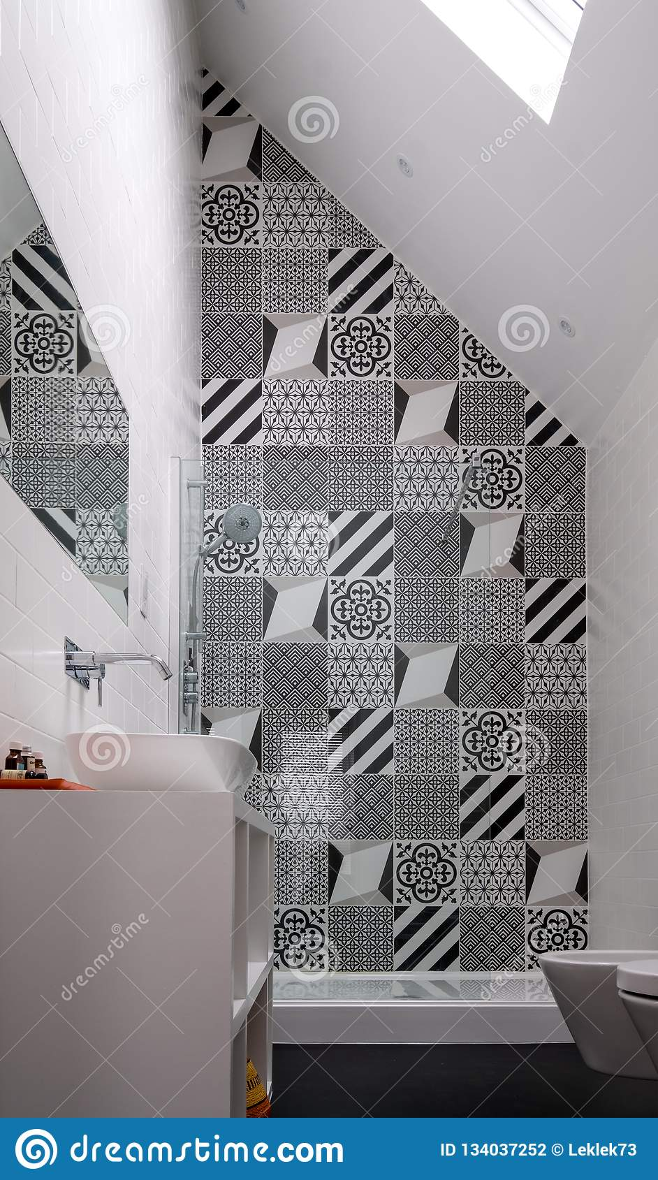 Bathroom With Shower Unit Toilet Bidet And Basin Unit With Black And White Monochrome Patchwork Tiles And High Ceiling Stock Photo Image Of Decor Patterned 134037252