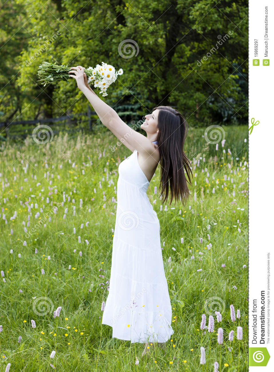 Innocent Girl Wallpaper Beautiful Girl Holding Flowers In A Meadow Stock Image